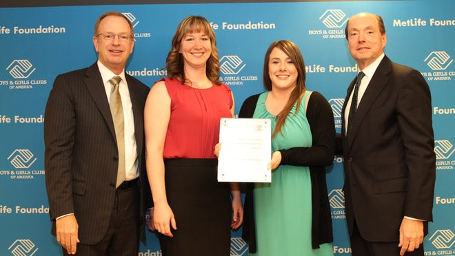 Kaitlynn Chritton and Katie Plumb of the Boys & Girls Club of Salem, Marion and Polk Counties accept the prestigious Merit Award for Program Excellence in Education and Career Development from Jim Clark, president of Boys & Girls Clubs of America in San Francisco, Calif.