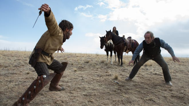 "Tim Blake Nelson (left) and Tommy Lee Jones star in ""The Homesman."""
