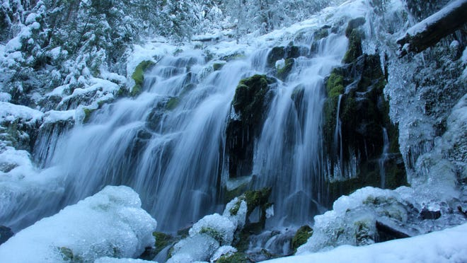 Upper Proxy Falls, located near Mckenzie Pass east of Eugene, can be visited during winter with a long snowshoe, ski or hiking trip up closed McKenzie Pass Highway 242.