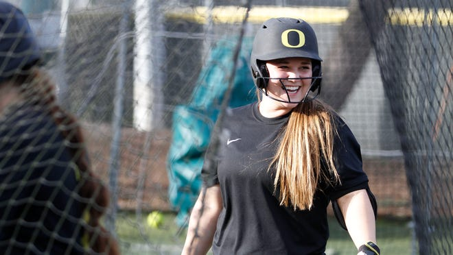 Ducks softball player Hailey Decker practices with teammates on Wednesday, Jan. 28, 2015, at Howe Field in Eugene , Ore.