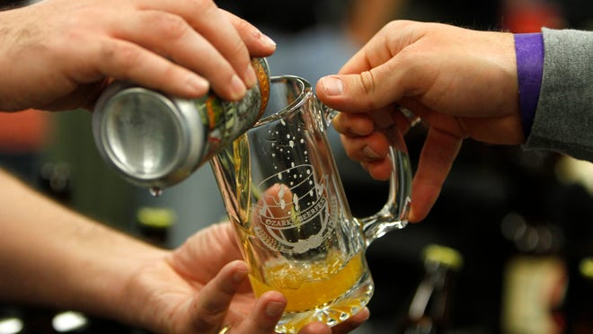 Beer was flowing from cans, bottles, and taps at Ozarks Beerfest at the Springfield Expo Center on Saturday, Nov. 22, 2014.
