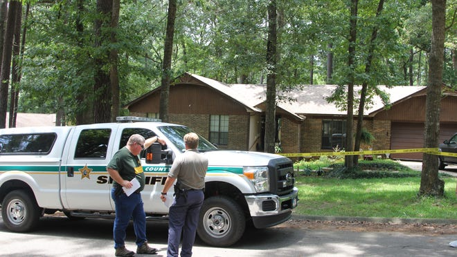 LCSO investigators work at the house in Killearn Lakes Plantation on Tuesday. Mason Rhinehart, 7, died after being stabbed. His grandmother will be charged, LCSO says.