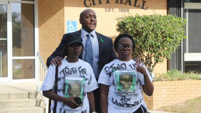 Kaldrick Donald's mother Juanita Donald, left, and sister Shameka Donald stand with their attorney Craig Brown outside of Gretna City Hall Thursday. Kaldrick Donald was fatally shot by a Gretna police officer Oct. 28 when he arrived to conduct a Baker Act.