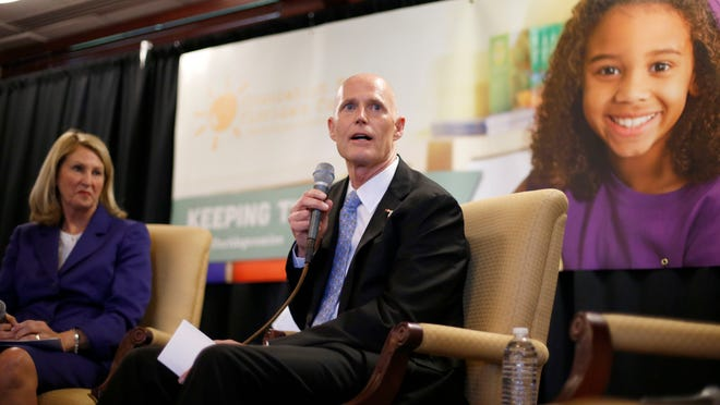 Gov. Rick Scott speaks, while seated next to Pam Stewart, the Commissioner of the Florida Department of Education, at the Florida Education Summit earlier this month.