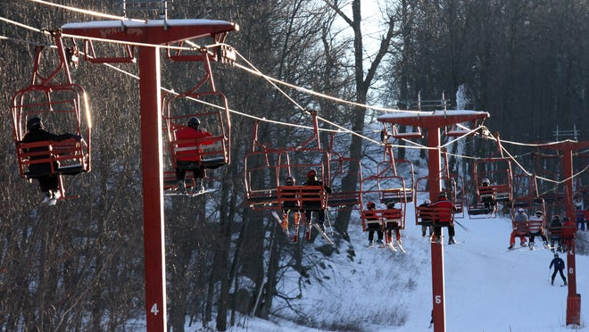 Skiers ride the lift before skiing down the slopes at Tuxedo Ridge in Tuxedo.