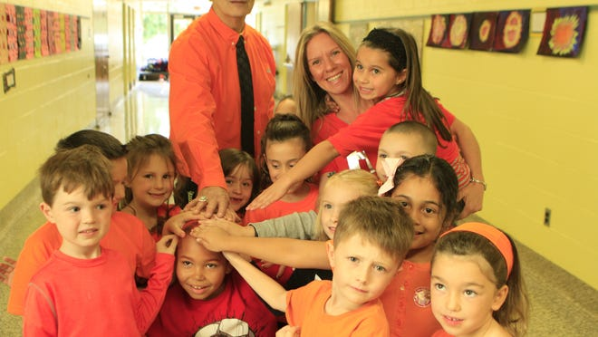 Stony Point Elementary School Assistant Pricipal David Reiner, left, parent organizer Kristine Cuffari and students wear orange clothing for National Bullying Prevention Month's Unity Day celebration in October 2012.