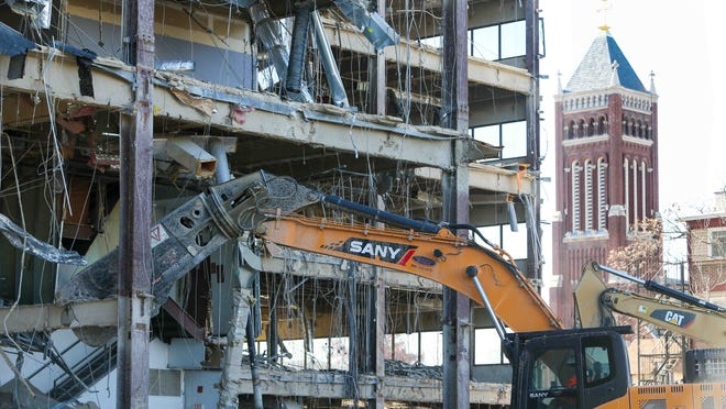 A construction crew tears down a building at 1001 Jefferson St. in downtown Wilmington to make room for a parking lot.