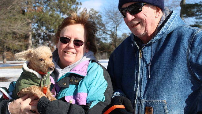 Sheeren and Chris Lindsay took their dog, Rusty, for his first walk all winter at the Wisconsin State Firefighters Memorial park in Wisconsin Rapids on Saturday.