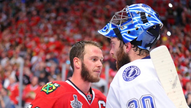 Chicago Blackhawks center Jonathan Toews (19) shakes hands with Tampa Bay Lightning goalie Ben Bishop (30) after game six of the 2015 Stanley Cup Final at United Center.