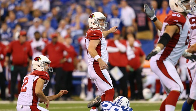 Sep 17, 2017: Arizona Cardinals kicker Phil Dawson (4) kicks the game winning field goal under pressure from Indianapolis Colts cornerback Chris Milton (28) in the overtime quarter at Lucas Oil Stadium. At left is Arizona Cardinals holder Andy Lee (2).