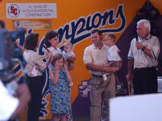 Angie Roberts, along with her husband Mark and their children Lauren, 8, Tyler, 5, and Caleb, 1, are interviewed on television in June of 2002 during the Children's Miracle Network telethon in Alexandria.