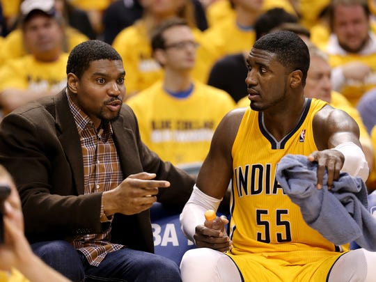 Pacers center Roy Hibbert talks to Andrew Bynum on the bench against the Atlanta Hawks in the first round of the NBA Eastern Conference playoffs Saturday, April 19, 2014, at Banker Life Fieldhouse.