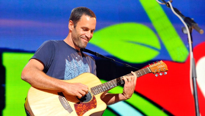 Jack Johnson performs during the Farm Aid 2013 concert  in Saratoga Springs, N.Y., on Sept. 21.