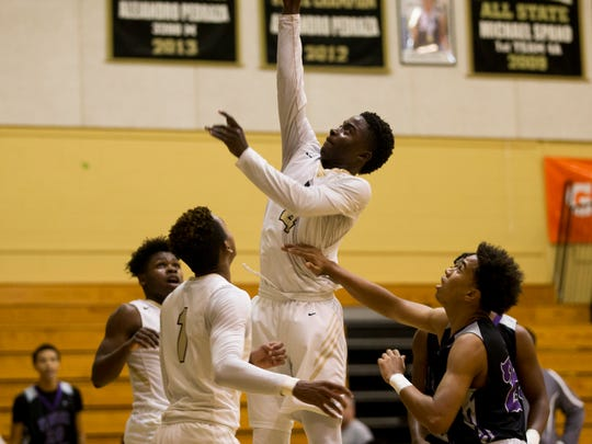 Golden Gate's Lovenson Xavier (4) lays the ball up against Timber Creek in the first half of a first round game at the Gulfshore Holiday Hoopfest at Golden Gate High School Wednesday, Dec. 27, 2017 in Golden Gate Estates. Timber Creek would go on to win 79-58.