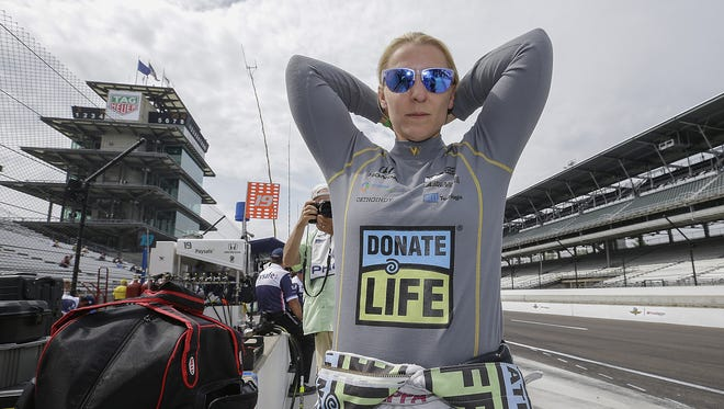 Dale Coyne Racing IndyCar driver Pippa Mann (63) prepares herself before practice for the Indianapolis 500 at the Indianapolis Motor Speedway on Wednesday, May 16, 2018.