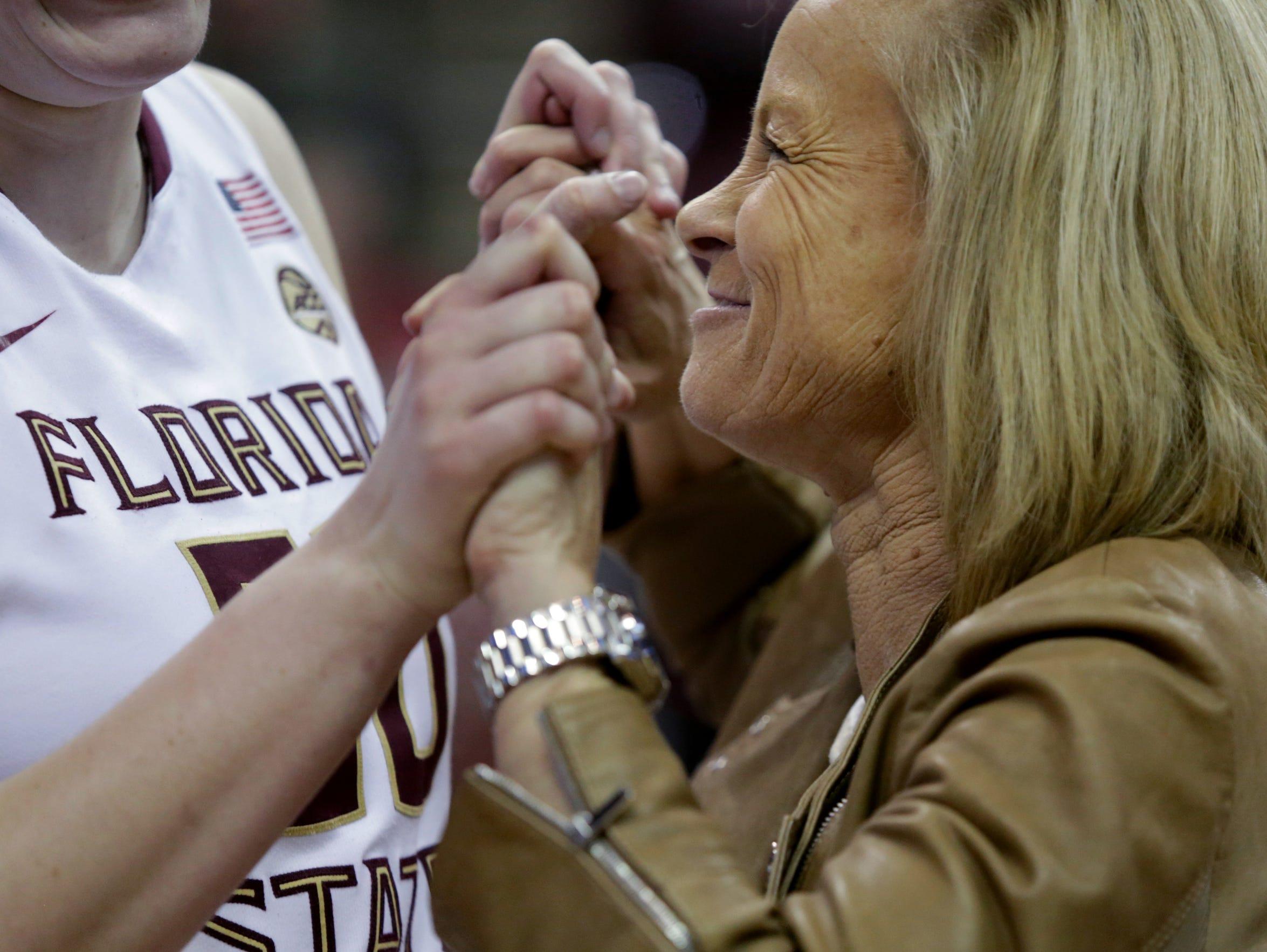 Florida State women's basketball coach Sue Semrau celebrates