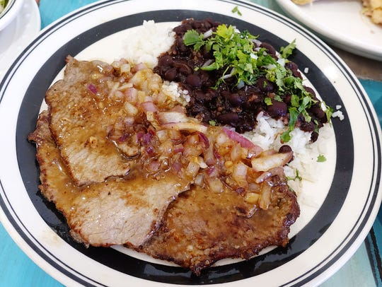 Bistec with rice and beans at The Latin Kitchen in
