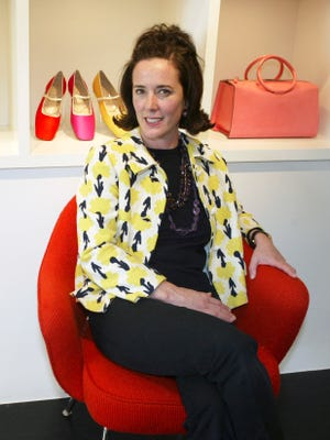 Kate Spade is pictured posing among handbags and shoes from her collection in New York.