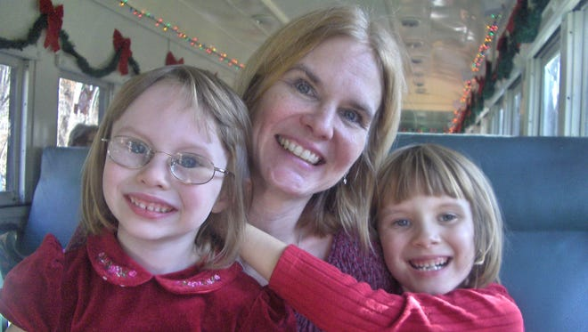 Theresa Gorski, who was killed in January 2013, is pictured with her two daughters.