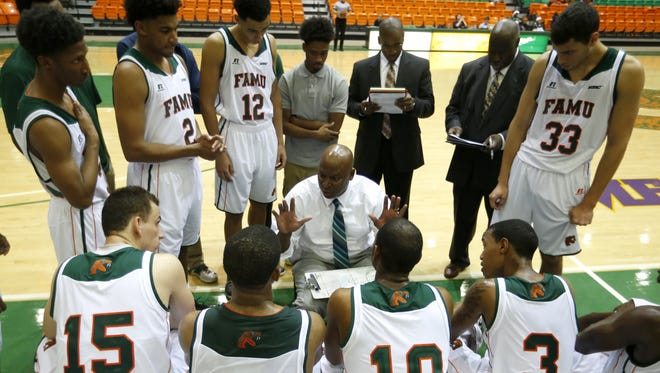 Joe Rondone/Democrat FAMU's head coach Byron Samuels talks to his team during their game against the University of North Florida on Friday.Ã'Â