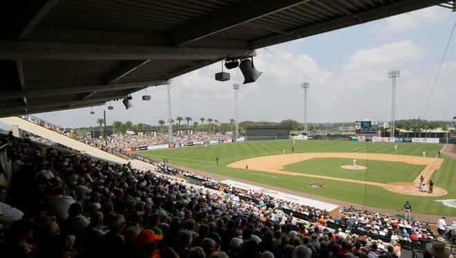 Baseball fans watch during a spring training exhibition baseball game between the Detroit Tigers and the New York Yankees at Joker Marchant Stadium in Lakeland, Fla., Friday, March 20, 2015.