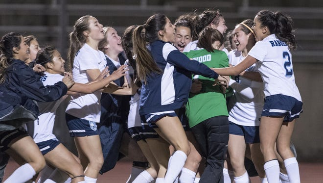 Redwood players celebrate their win over Sanger in a Central Section Division II championship girls soccer game on Friday, February 24, 2017.