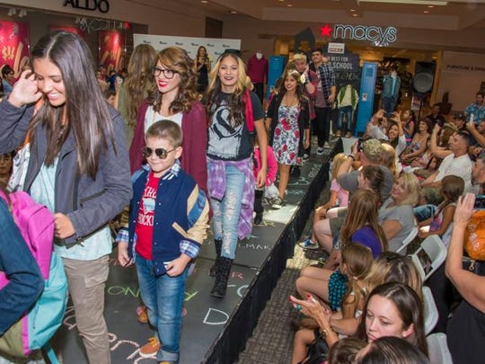 Models walk the runway part of a Westfield Palm Desert back-to-school fashion show.