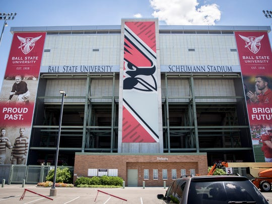 FILE -- Scheumann's banners clocked in at an impressive 21 feet wide by 80.5 feet tall with historic photos of Ball State's football program on one and photos of Coach Mike Neu and then-tight end Danny Pinter on the other.