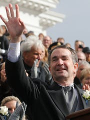 Virginia Gov. Ralph Northam waves to the crowd after
