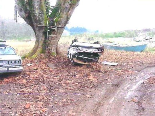 An overturned car at 6331 Liberty St. in South Salem before the property burned down.