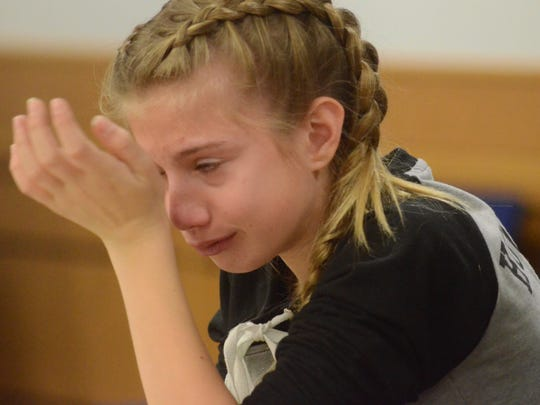 Brandee Stenman-Milcher cries as she tells the judge about the death of her sister.