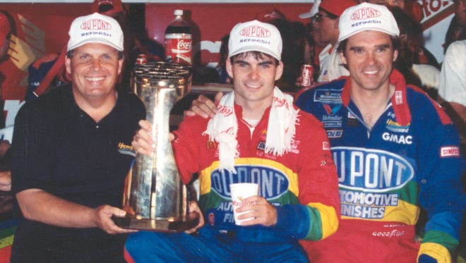Team owner Rick Hendrick (left) and crew chief Ray Evernham help Jeff Gordon celebrate the first of his 93 Cup race wins, at Charlotte Motor Speedway on May 29, 1994.