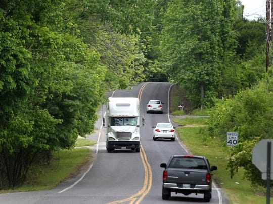 Traffic moves along Holmes Road east of Horn Lake Road, an area that was approved to be widened in the fiscal 2011 budget by former interim county mayor Joe Ford.