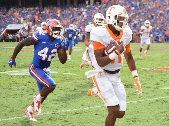 Vols quarterback Joshua Dobbs (11) beats Florida defensive