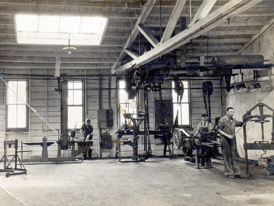 Some of the skilled employees of Schaal's Garage at work in the early 1900s.