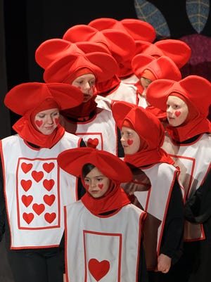 """Youth actors played the part of a deck of cards in """"Alice In Wonderland"""" by Missoula Children's Theatre at the Thrasher Opera House in Green Lake in this file photo. Auditions will be held at the Grand Opera House on April 17 for """"Treasure Island,"""" which will be performed April 22 at the Grand."""