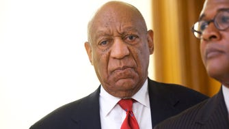 Actor and comedian Bill Cosby reacts while being notified a verdict was in in his sexual assault retrial, April, 26, 2018.