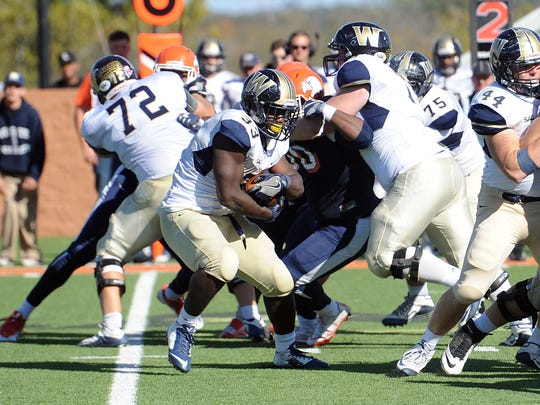 Wingate running back Blake Hayes carries the ball against Carson-Newman Saturday at Burke-Tarr Stadium in Jefferson City.