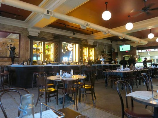 The handsome bar at Ottava Via in Detroit's Corktown is the focal point of the dining room, set in the