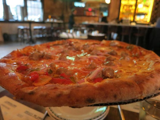 The Italian tavern menu at Ottava Via in Corktown include thin-crust pizzas baked in a stone-hearth oven.