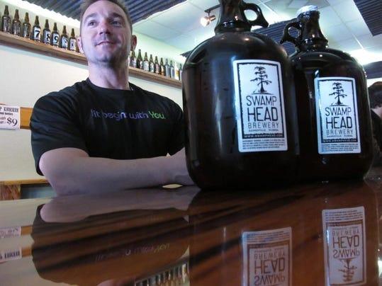 -TLHBrd_11-26-2013_Democrat_1_B003~~2013~11~25~IMG_Illegal_Beer_Growler_1_1_.jpg