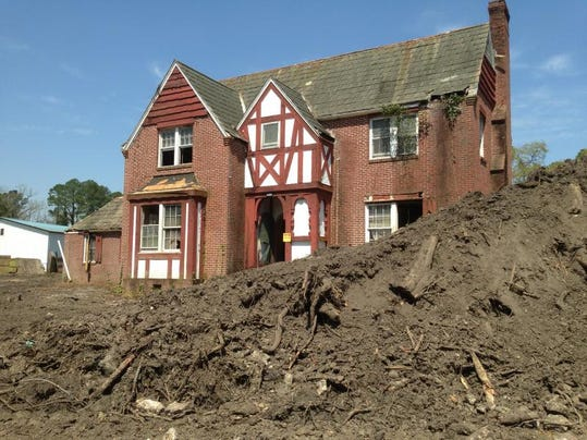 House and dirt mound art