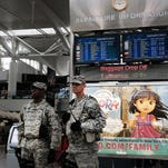 Soldiers stand guard at JFK in New York on March 24, 2016.