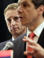 Robert Duffy, left, and Andrew Cuomo participate in a news conference in New York, Wednesday, May 26, 2010. Cuomo introduced Duffy as his running mate.