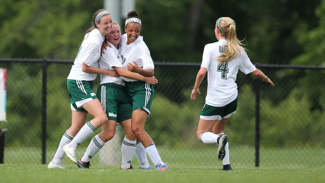 Members of the Iowa City West girls soccer team celebrate a first-half goal over Dowling Catholic during the Iowa Class 3A state soccer championship match at Cownie Sports Complex in Des Moines on Saturday, June 13, 2015.