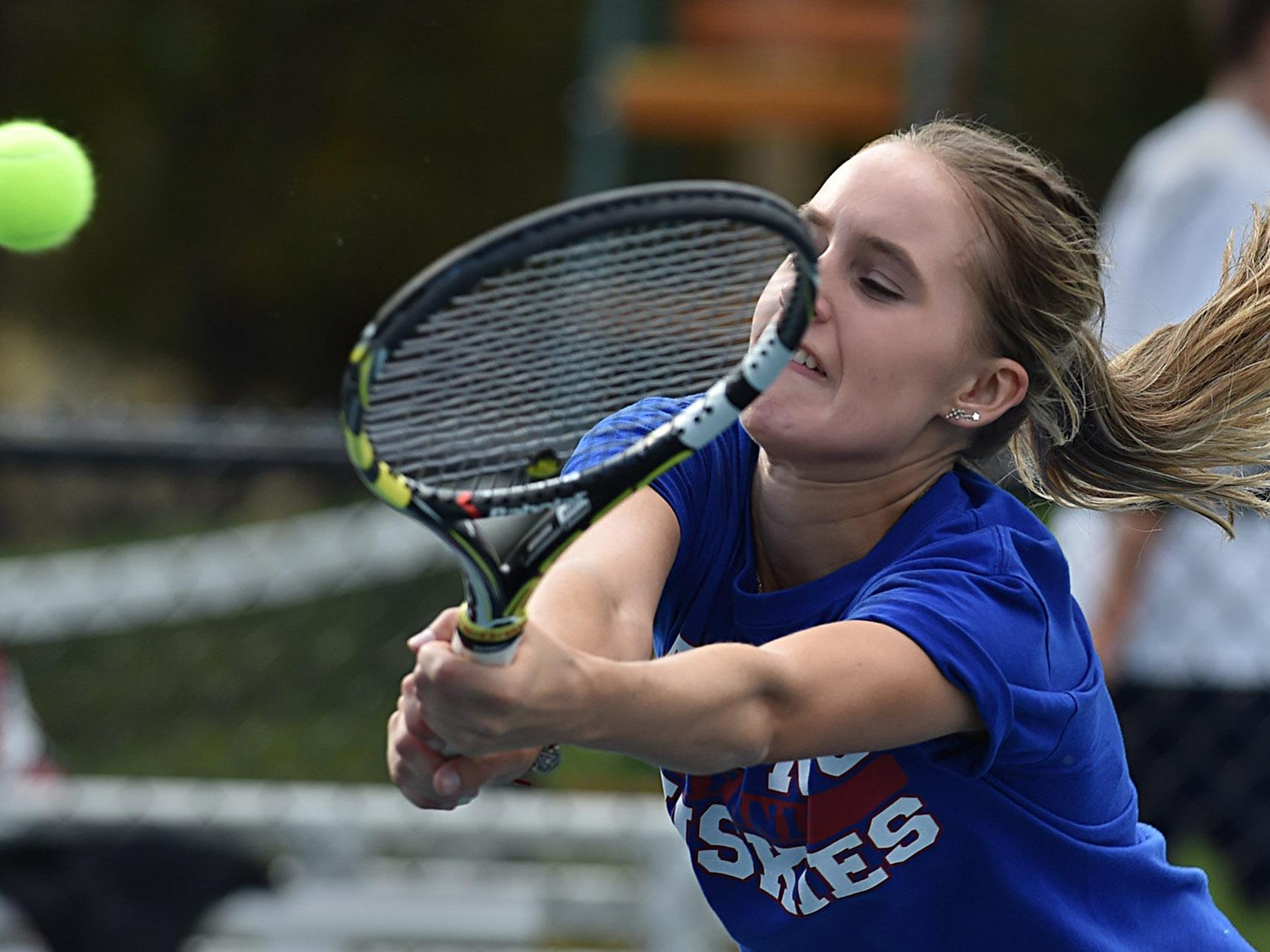 Reno's McKenna Levitt reaches for a backhand during the girls singles final at the Caughlin Athletic Club on Monday.