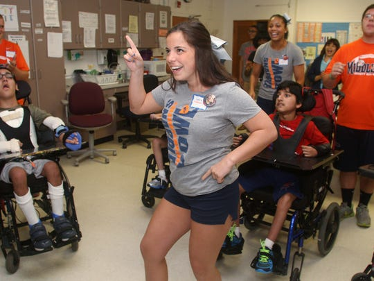 Snapple Bowl cheerleader Sara Bozzomo of Middlesex dances to a Michael Jackson song during the team's visit to the Lakeview School.