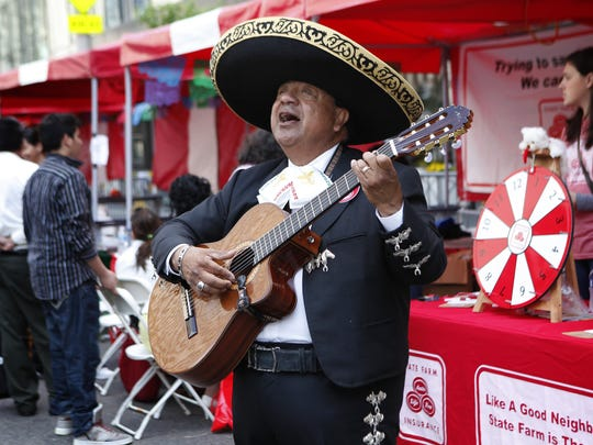Carlos Flores of Newport serenades festival goers during the Cincy-Cinco Latino Festival in 2011.
