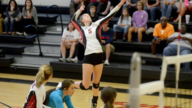South Side's Shea Dean goes up for a kill during Tuesday night's volleyball match against Lexington.