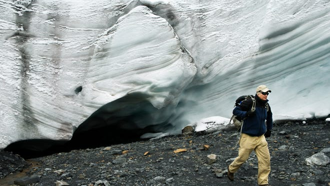 Bryan Mark, a scientist at the Byrd Polar and Climate Research Center at Ohio State University, walks by the Pastoruri Glacier in Huascaran National Park in the Cordillera Blanca of the Andes Mountains of Peru on March 4, 2015. Pastoruri Glacier is quickly diminishing in size and some say will be completely gone in a decade.